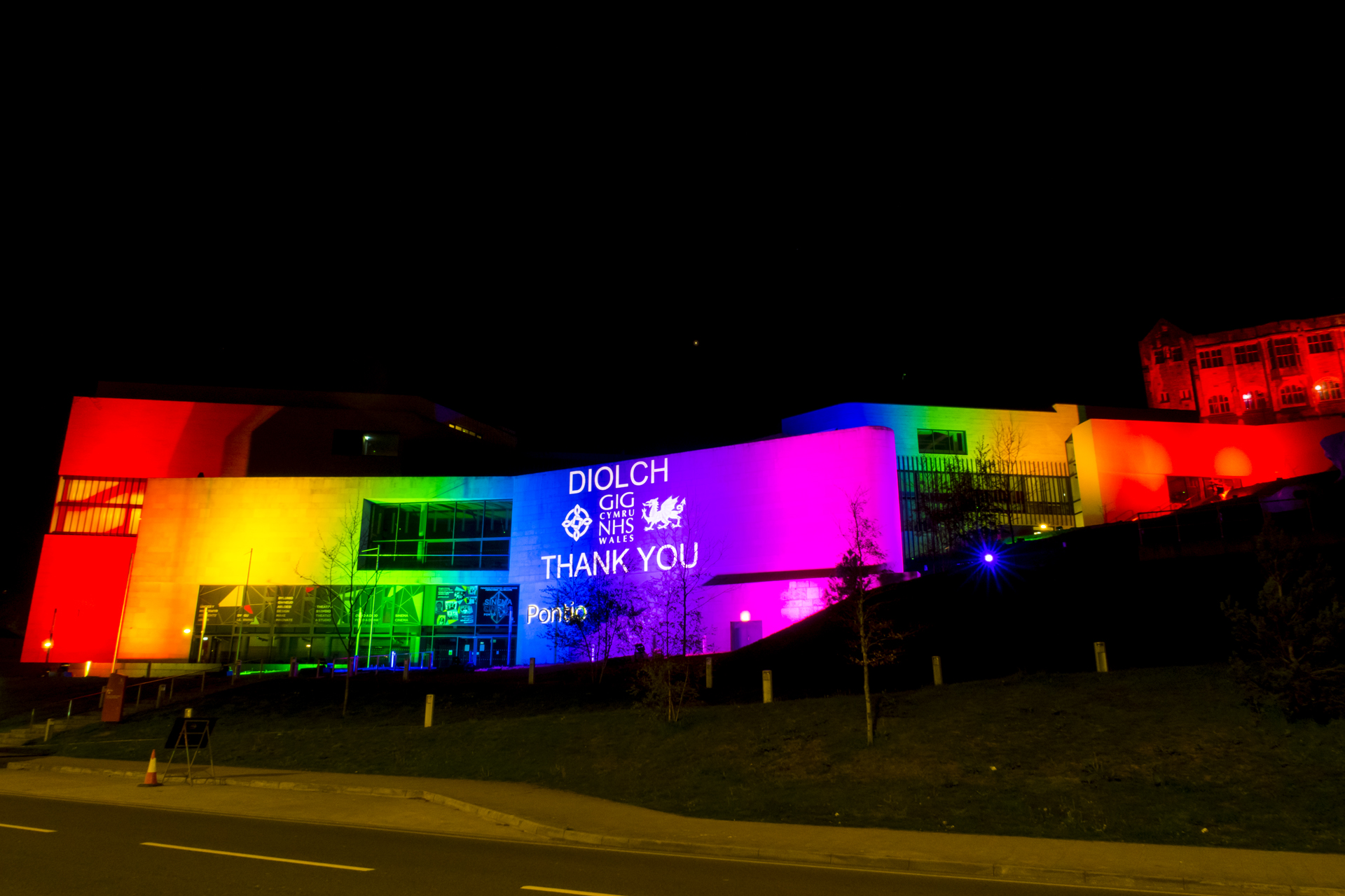 Outdoor rainbow lighting and projection at Pontio Theatre & Bangor university