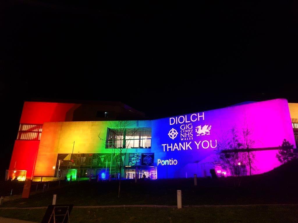 Outdoor rainbow lighting and projection at Pontio Theatre & Bangor university