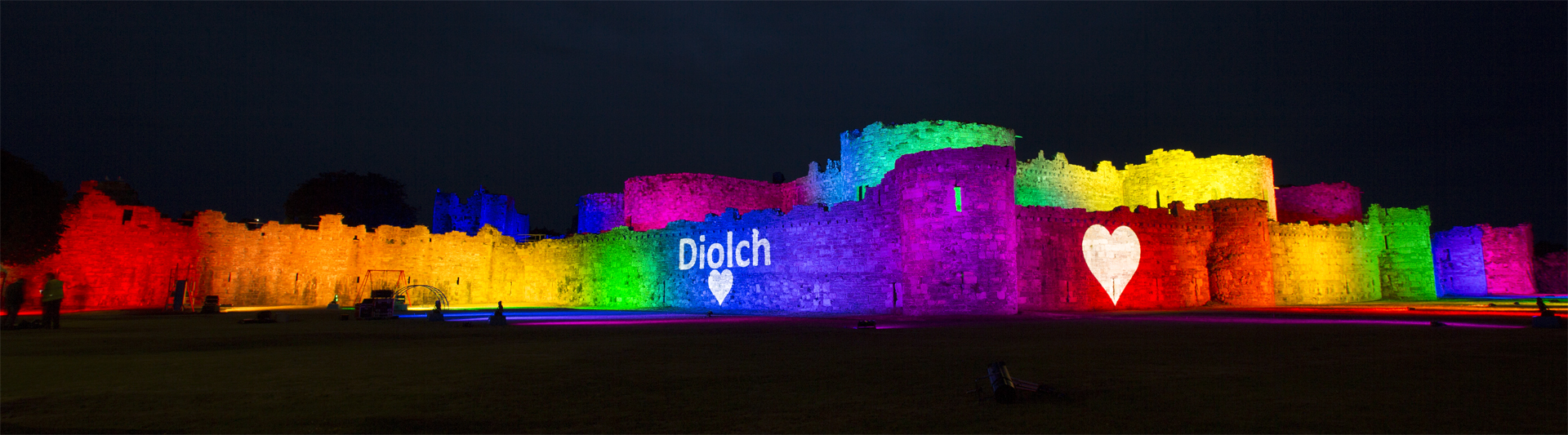 Beaumaris Castle Lit Up Rainbow Lighting Lights Outdoor Building Projection Mapping NHS