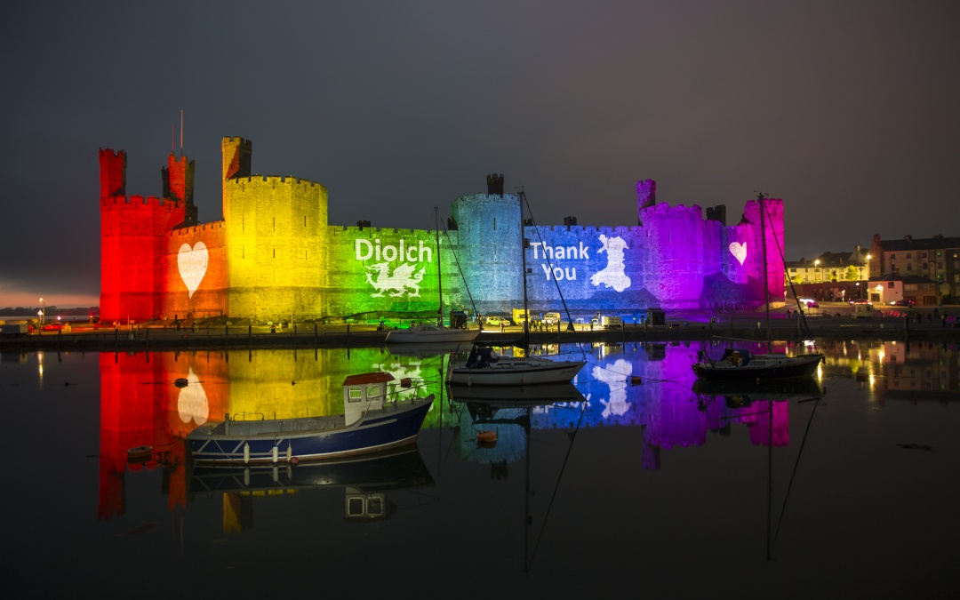 Caernarfon Castle Lit Up with a Rainbow of Lights