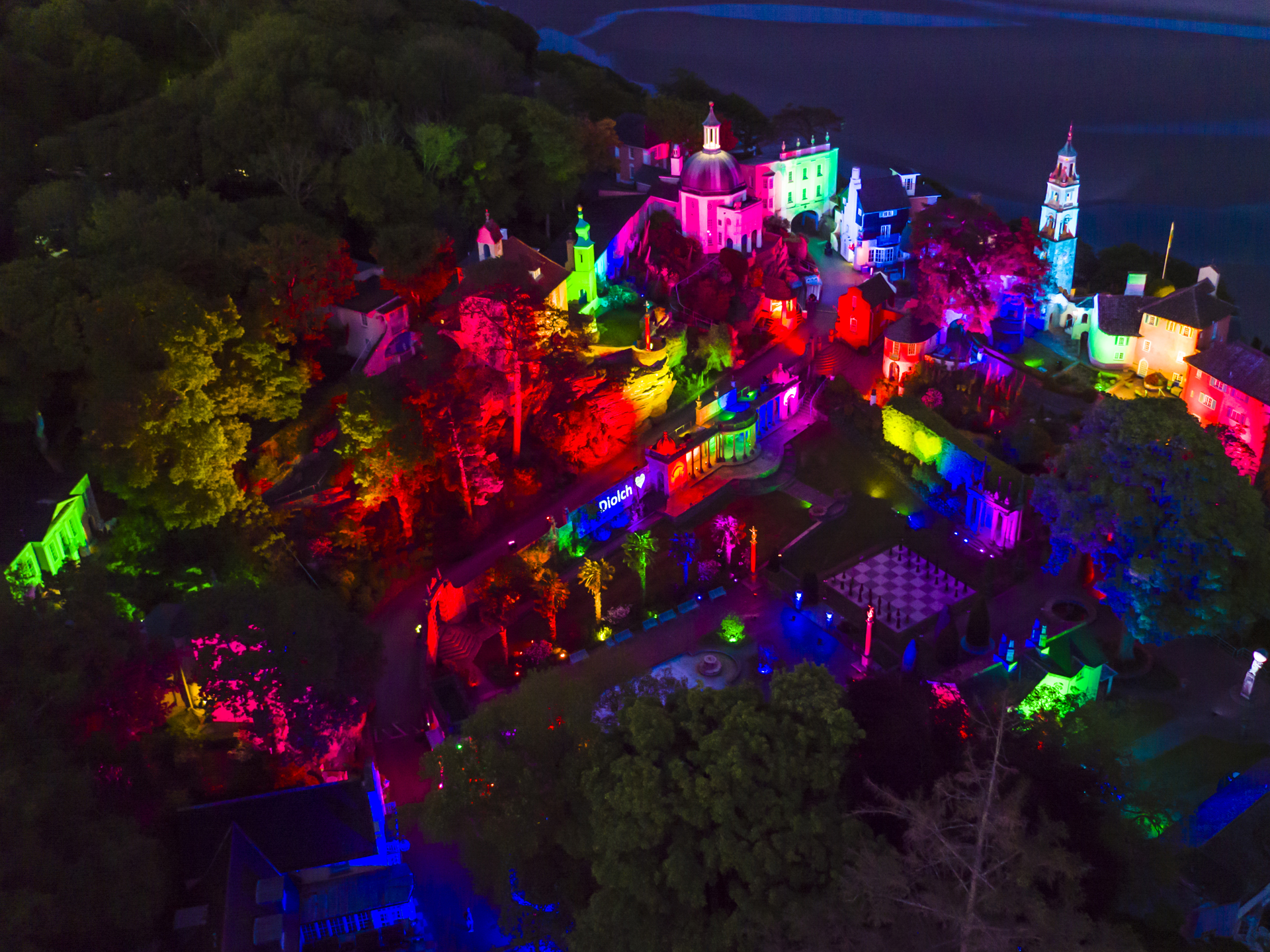 Portmeirion Lit Up Rainbow Lighting Lights Outdoor Building Projection Mapping NHS